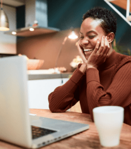 Lady smiling at her laptop